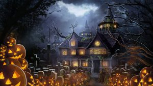 Haunted building with lit pumpkins surrounding front yard